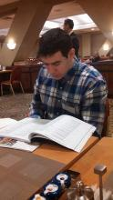 Lehigh University Science and Environmental Writing student reading the AAAS program book