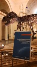 Lehigh University Science and Environmental Writing - image of Tyrannosaurus Rex behind a poster of a recent conference